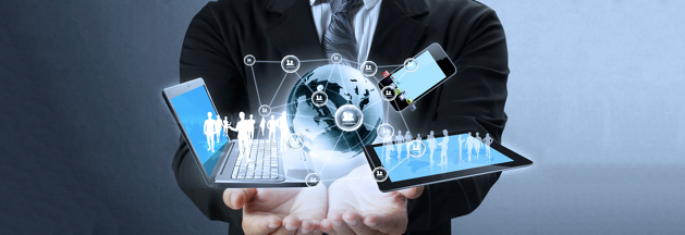 a businessman holding a laptop, Ipad, mobile phone and globe in his hands