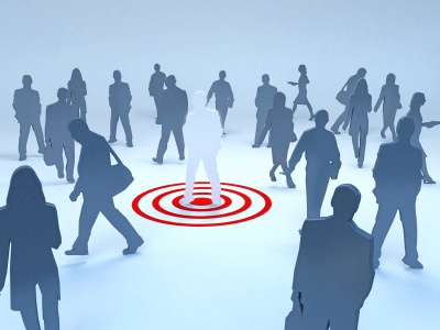 a man standing on a target in a crowd to depict target audience