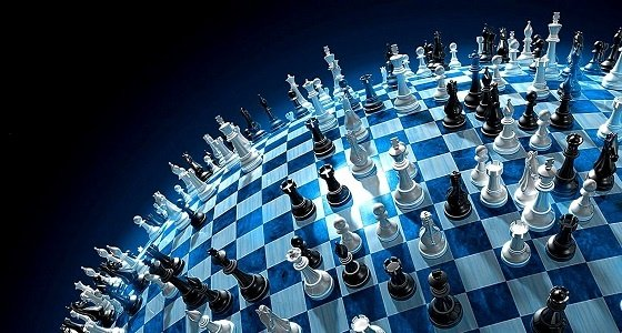 A large chess board with many chess pieces on it